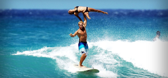 Two Gymnasts Pull Off Incredible Stunts in Surfing Competition